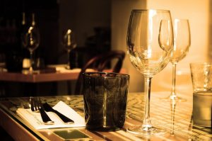 wineglass-and-glass-on-table-in-restaurant