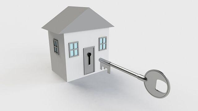 Imagen de una casa con una llave